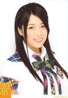 前田栄子(手束真知子) /上半身・衣装白・緑・チェック柄・笑顔/「2009 SKE48」/ガチャ引き換え生写真
